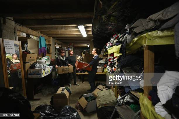 Volunteers work in the clothes store run by the charity 'SALAM' who also prepare hot meals for their daily distribution to migrants on October 28...