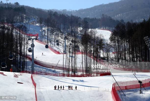 Volunteers work on course at Jeongseon Alpine Center during previews ahead of the PyeongChang 2018 Winter Olympic Games on February 4 2018 in...