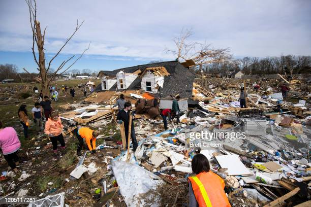 Volunteers work to clean up tornadodamaged areas on March 4 2020 in Cookeville Tennessee A tornado passed through the Nashville area early Tuesday...