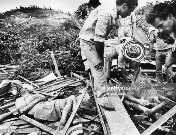 Volunteers work to free Primo Gomez who is tapped by debris from the eruption of Nevado del Ruiz Volcano in Armero Columbia on Nov 15 1985 His friend...