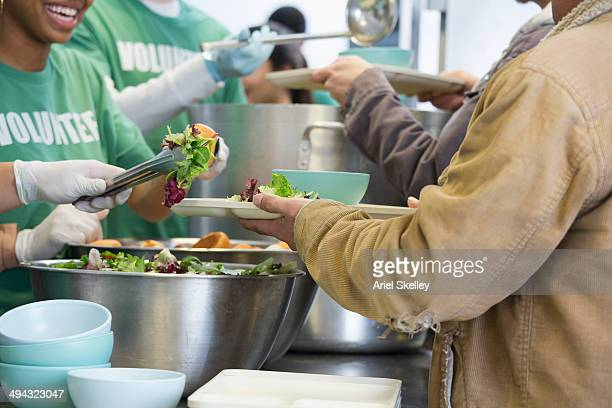 volunteers working in soup kitchen - humanitarian aid stock pictures, royalty-free photos & images
