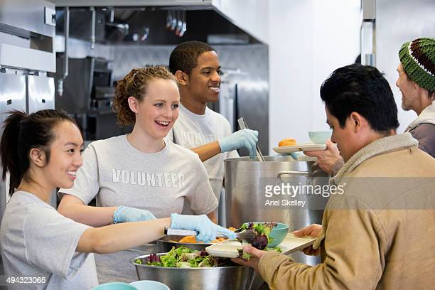 Volunteers working in soup kitchen