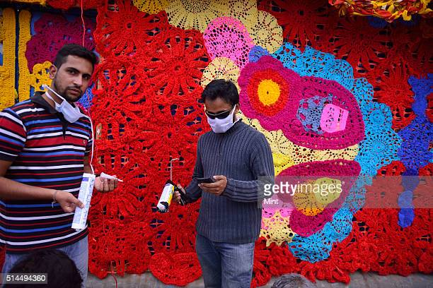 Volunteers working on the artwork installation by New Yorkbased artist Crocheted Olek converting a 40x8 ft night shelter for homeless near Sarai Kale...