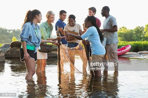 Volunteers working together in river