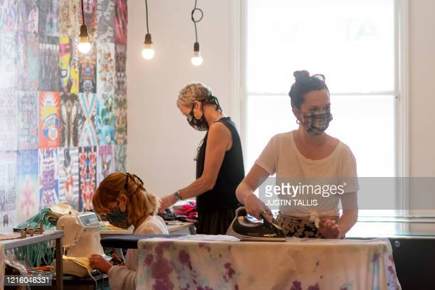 Volunteers works in face masks at the design studio of the sewing collective Masks for Extraordinary People in south London on May 28 2020 where they...