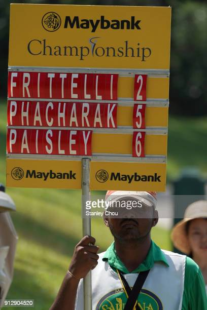 A voluntteer carries the scoreboard during day one of the 2018 Maybank Championship at Saujana Golf and Country Club on February 1 2018 in Kuala...