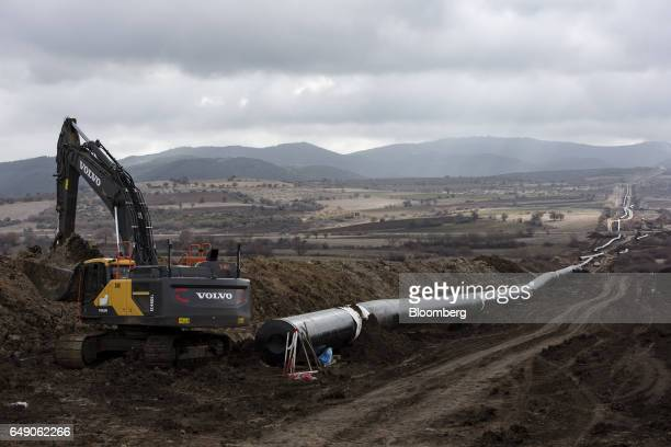 A Volvo AB crawler excavator digs a trench at the 6825km point during the construction of the Trans Adriatic gas pipeline in Chamilo Greece on...