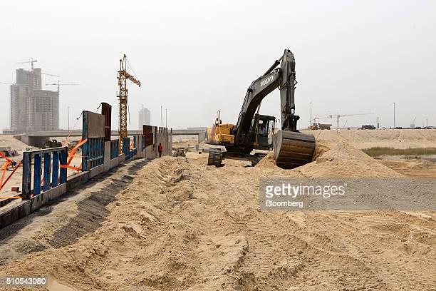 Volvo AB digger excavates sand on reclaimed land at the Eko Atlantic city site, developed by Eko Atlantic, near Victoria island in Lagos, Nigeria, on...