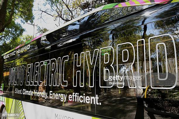 Volvo AB signage is displayed on the side of a new Volvo electric hybrid passenger bus during the inaugural trip in partnership with the World Wide...