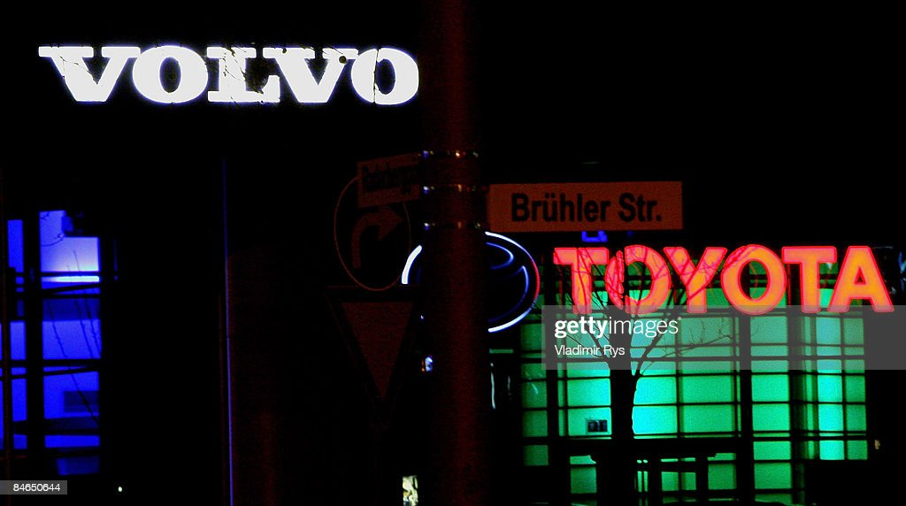 0c060b7886 Volvo and Toyota car dealers signage is seen by night February 4 ...