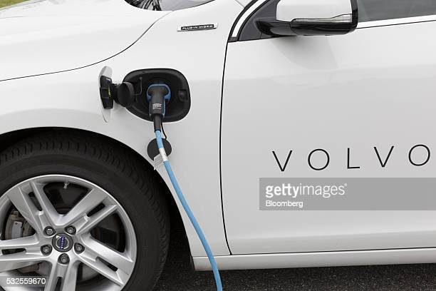 A Volvo DriveE powered automobile charges at an electric power point at the headquarters of Volvo Car Group in Torslanda Sweden on Wednesday May 18...