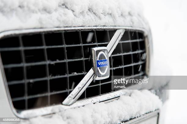 volvo in winter - grille stock photos and pictures