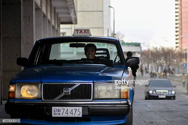 Volvo taxi waits outside a fourstar hotel
