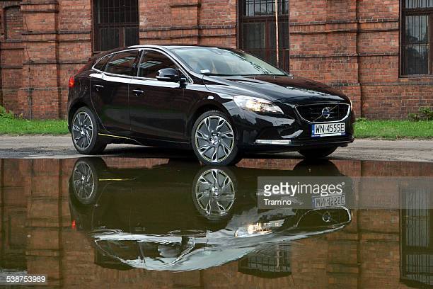 volvo v40 in the mirror reflection - volvo stock pictures, royalty-free photos & images