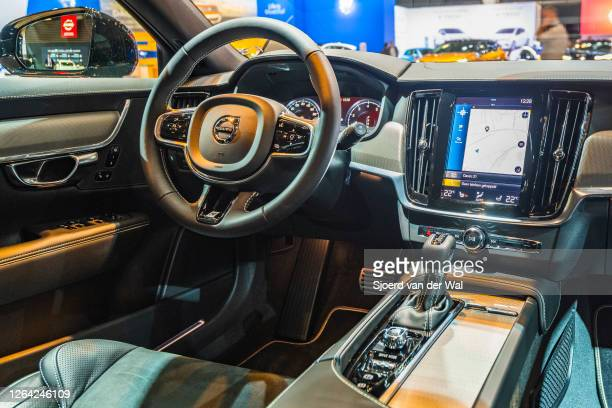 Volvo V90 luxury estate car dashboard on display at Brussels Expo on January 9, 2020 in Brussels, Belgium. The V90 is equipped with a large touch...