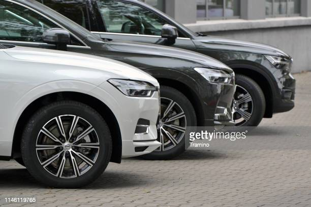 volvo vehicles on the parking - volvo stock pictures, royalty-free photos & images