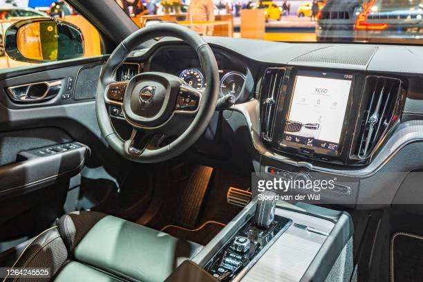 Volvo XC60 crossover SUV dashboard on display at Brussels Expo on January 9, 2020 in Brussels, Belgium. The XC60 is available with petrol and diesel...