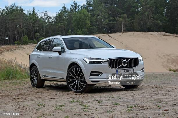 volvo xc60 on the unmade road - volvo stock pictures, royalty-free photos & images