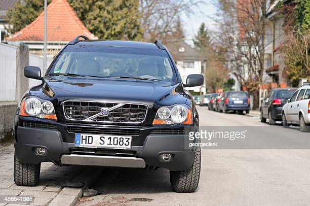 volvo xc90 on the street - curb stock pictures, royalty-free photos & images