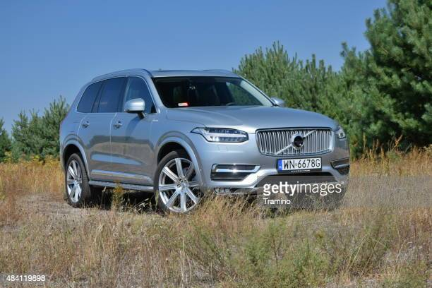 volvo xc90 on the unmade road - volvo stock pictures, royalty-free photos & images