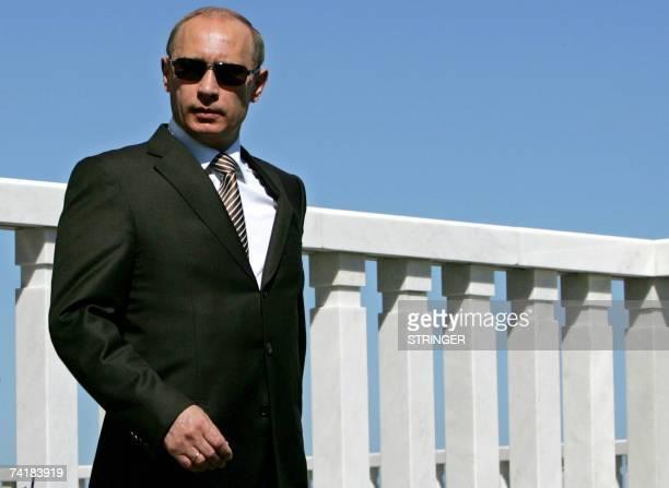 Volzhsky Utes, RUSSIAN FEDERATION: Russian President Vladimir Putin waits to meet German Chancellor Angela Merkel and the European Commission chief...