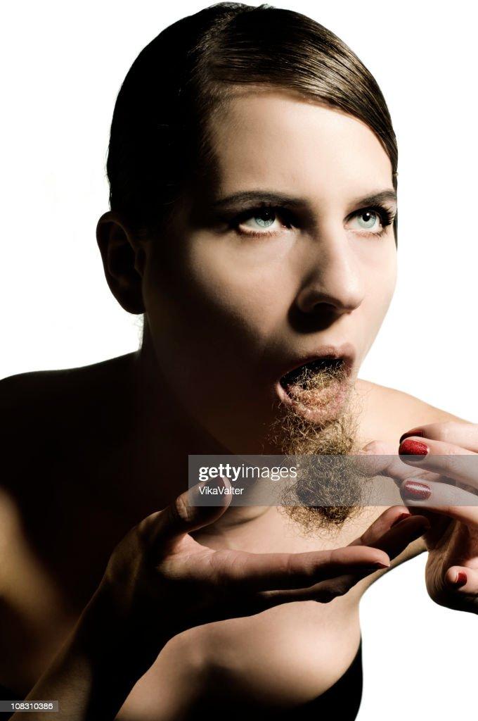 vomiting a hair ball : Stock Photo