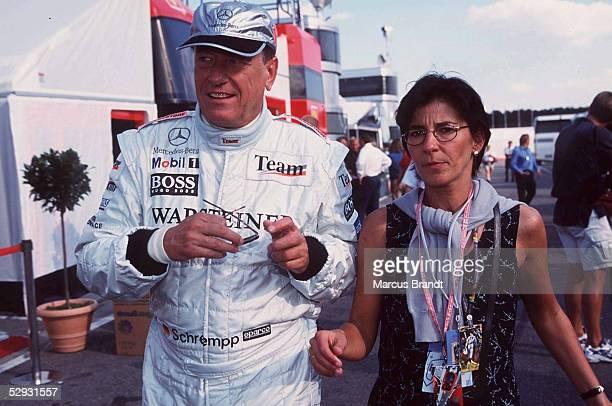 FORMEL 1 GP von DEUTSCHLAND 1999 Hockenheimring 310799 DAIMLER CHRYSLER CHEF Dr Juergen SCHREMPP mit Lebemsgefaehrtin