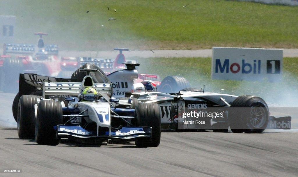 GP von Deutschland 2003, Hockenheim; Crash Startunfall zwischen Ralf SCHUMACHER/GER - BMW Williams - (links), Kimi RAEIKKOENEN/FIN - Mercedes McLaren - (rechts) und Rubens BARRICHELLO/BRA - Ferrari -