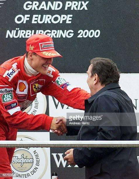 GP von EUROPA 2000 Nuerburgring SIEGEREHRUNG GRATULATION von BUNDESKANZLER Gerhard SCHROEDER fuer den SIEGER Michael SCHUMACHER/GER FERRARI