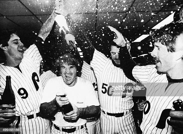 Von Hayes Pete Rose Marty Bystrom and Mike Schmidt of the Philadelphia Phillies celebrate in the locker room after defeating the Los Angeles Dodgers...
