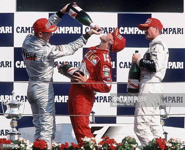 GP von ITALIEN 2000 in Monza SIEGEREHRUNG 2 Mika HAEKKINEN/FIN MERCEDES McLAREN SIEGER Michael SCHUMACHER/GER FERRARI 3 Ralf SCHUMACHER/GER BMW...