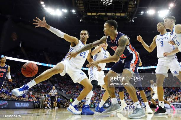 Von McCormick of the Auburn Tigers passes the ball against PJ Washington of the Kentucky Wildcats during the 2019 NCAA Basketball Tournament Midwest...