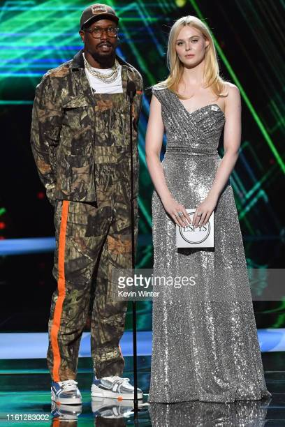 Von Miller and Elle Fanning speak onstage during The 2019 ESPYs at Microsoft Theater on July 10, 2019 in Los Angeles, California.