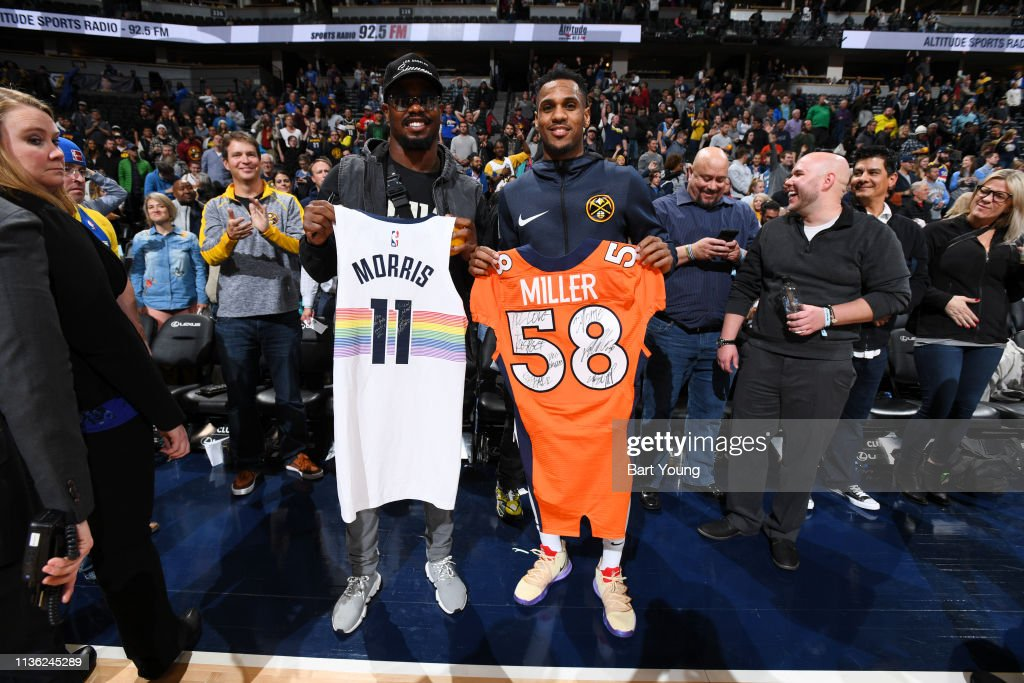 uk availability 736b2 0fd5b Von Miller and Monte Morris of the Denver Nuggets exchange ...