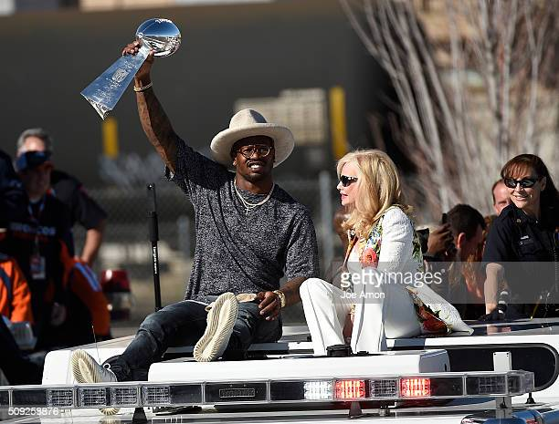 Von Miller hoists the Vince Lombardi trophy above his head as the trucks pull onto the parade route Annabel Bowlen sits next to him The city of...