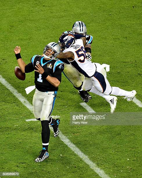Von Miller of the Denver Broncos forces Cam Newton of the Carolina Panthers to fumble the ball during the fourth quarter of Super Bowl 50 at Levi's...