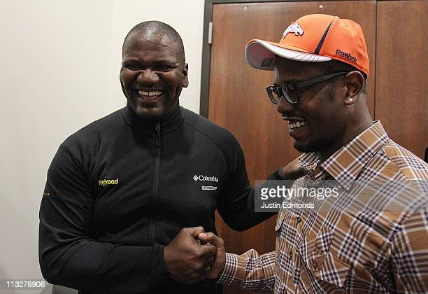 Von Miller of the Denver Broncos is congratulated by former Bronco linebacker and defensive end Alfred Williams at Dove Valley on April 29 2011 in...