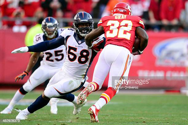 Von Miller of the Denver Broncos misses a tackle on Cyrus Gray of the Kansas City Chiefs during the first half of action at Arrowhead Stadium The...