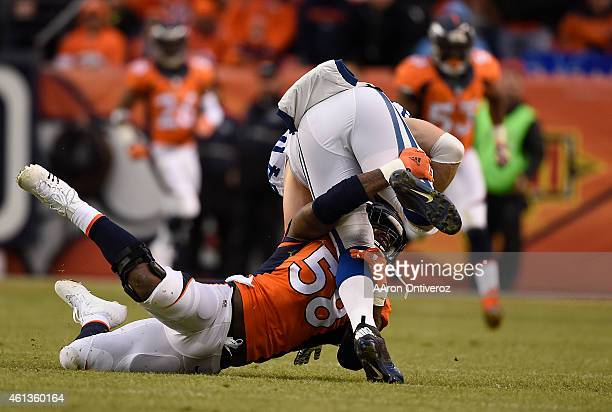 Von Miller of the Denver Broncos stops Jack Doyle of the Indianapolis Colts on a gain of 4 yards in the second quarter The Denver Broncos played the...