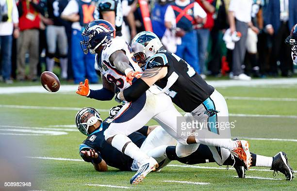 Von Miller of the Denver Broncos strips the ball from Cam Newton of the Carolina Panthers in the first quarter during Super Bowl 50 at Levi's Stadium...
