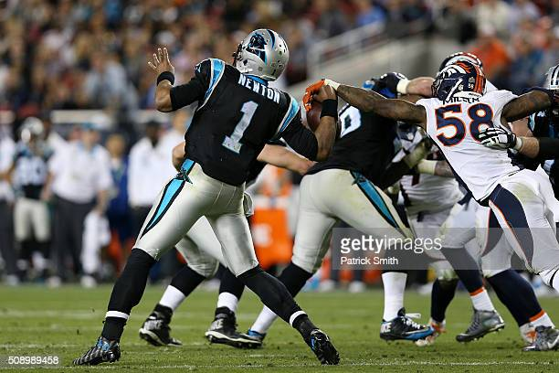 Von Miller of the Denver Broncos strips the ball from Cam Newton of the Carolina Panthers in the fourth quarter during Super Bowl 50 at Levi's...