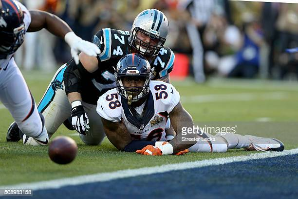 Von Miller of the Denver Broncos watches the ball after stripping Cam Newton of the Carolina Panthers during Super Bowl 50 at Levi's Stadium on...