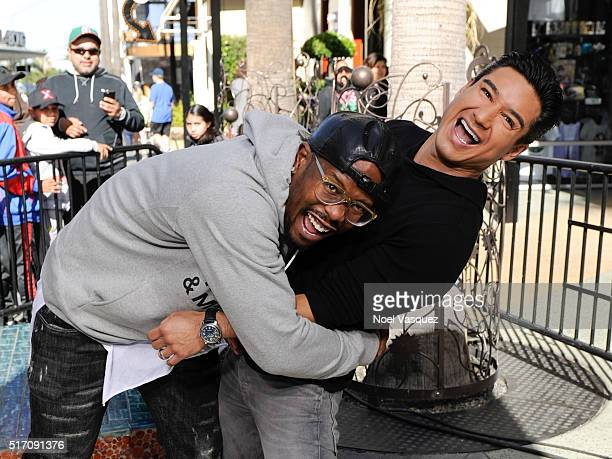 Von Miller tackles Mario Lopez at 'Extra' at Universal Studios Hollywood on March 23 2016 in Universal City California