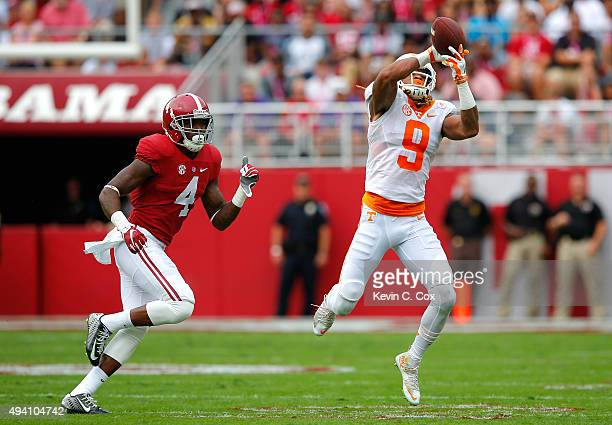 Von Pearson of the Tennessee Volunteers pulls in this reception against Eddie Jackson of the Alabama Crimson Tide at BryantDenny Stadium on October...