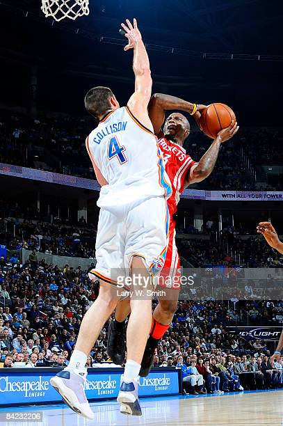 Von Wafer of the Houston Rockets goes to the basket against Nick Collison of the Oklahoma City Thunder at the Ford Center on January 9 2009 in...