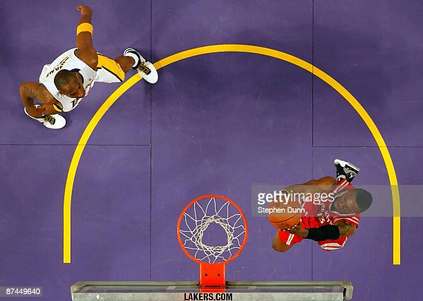 Von Wafer of the Houston Rockets goes up for a dunk in front of Kobe Bryant of the Los Angeles in Game Seven of the Western Conference Semifinals...