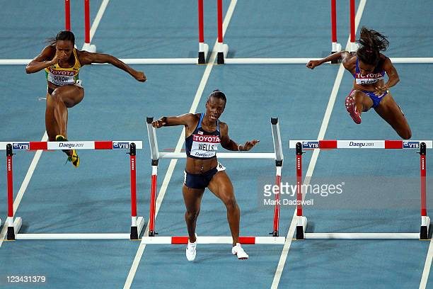 Vonette Dixon of Jamaica Kellie Wells of United States and Lina Florez of Columbia compete in the women's 100 metres hurdles semi finals during day...