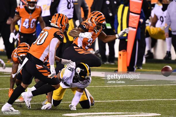 Vonn Bell of the Cincinnati Bengals forces a fumble by JuJu Smith-Schuster of the Pittsburgh Steelers during the first quarter at Paul Brown Stadium...