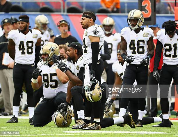 Vonn Bell Tyeler Davison Sterling Moore of the New Orleans Saints and teammates watch from the sidelines as PJ Williams is tended to by medical staff...
