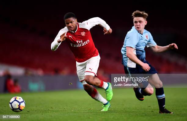 Vontae DaleyCampbell of Arsenal takes on Finlay SinclairSmith of Blackpool during the FA Youth Cup Semi Final 2nd Leg between Arsenal and Blackpool...